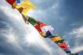pic of mantra  - tibetan flags with mantra on sky background - JPG