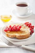 french toast with redcurrant and honey for breakfast