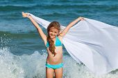 Free as the waves of te sea with girl enjoying the breeze on the beach