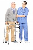 Full length portrait of a male nurse helping a senior man with walker isolated on white background