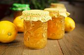Citrus and ginger jam on wood table