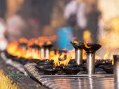 picture of yangon  - Burning oil lamps at the Shwedagon Pagoda in Yangon the capital of Republic of the Union of Myanmar - JPG