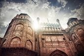 stock photo of india gate  - Lahore Gate of Red Fort at dramatic sky in Old Delhi India - JPG