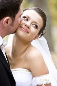 Groom Kissing Charming Smiling Bride