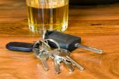 foto of underage  - image of keys and alcohol a drink driving concept image  - JPG