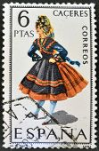A stamp printed in Spain dedicated to Provincial Costumes shows a woman from Caceres
