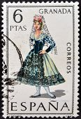 A stamp printed in Spain dedicated to Provincial Costumes shows a woman from Granada