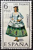 A stamp printed in Spain dedicated to Provincial Costumes shows a woman from Las Palmas