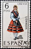 A stamp printed in Spain dedicated to Provincial Costumes shows a woman from Orense