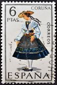 A stamp printed in Spain dedicated to Provincial Costumes shows a woman from Coruña