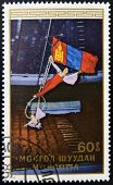 A stamp printed in Mongolia shows Two acrobats