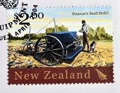 stamp printed in New Zealand dedicated to historic farm equipment shows Duncan´s Seed Drill