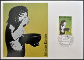 A stamp printed in Liechtenstein dedicated to year of the child shows child eating