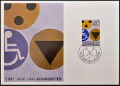 A stamp printed in Liechtenstein shows symbols for the disabled
