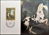 stamp dedicated to paintings of Golden Carriage and Horses shows portrait of a Plebald