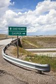 stock photo of casper  - Roadside sign providing directions to Casper and Cheyenne Wyoming along a rural Wyoming highway - JPG