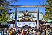TOKYO, JAPAN - MARCH 23, 2014: Tourists crowd Yasukuni Shrine. The shrine is one of the most controversial in Japan housing the remains of 14 class A war criminals.