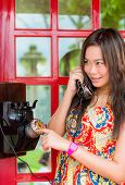 foto of phone-booth  - Thai girl is talking with an old - JPG