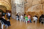 JERUSALEM, ISRAEL - AUGUST 21, 2013: Prayers inside the Cave Synagogue which is a part of Western Wa