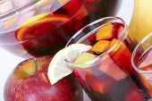 stock photo of sangria  - Sangria in glass bowl closeup on white - JPG