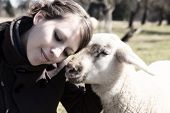 Young Woman Leaning Head On Sweet Lamb, Light Filters
