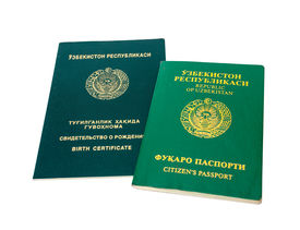 stock photo of passport template  - Uzbekistan passport and birth certificate isolated on the white background  - JPG