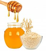 pic of ladle  - honey in jar with ladle and oatmeal on a white background - JPG