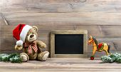 picture of teddy  - nostalgic christmas decoration with antique toys teddy bear and wooden rocking horse - JPG