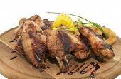 chicken wings are grilled