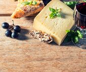 Cheese With Red Wine, Walnuts And Grapes. Food Ingredients