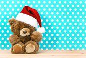 Teddy Bear With Santa's Hat. Christmas Decoration