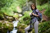 Woman Hiker Crossing The River