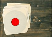 Vintage Vinyl Records On Rustic Wooden Background