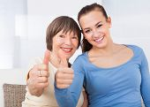 Caregiver And Senior Woman Showing Thumbs Up