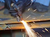 Worker Use Acetylene Torch To Cutting Metal