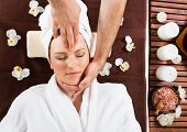 Young Woman Receiving Head Massage At Spa