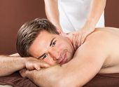 Man Receiving Back Massage In Spa