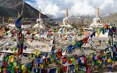 stock photo of nepali  - Prayer flags with stupas  - JPG