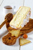 French Soft Spicy Cheese From Cow's Milk And Items From The Olive Tree