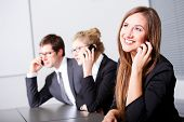 Business People Having Phonecall In Meeting