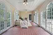 pic of screen-porch  - Porch in suburban home with red brick floor - JPG