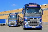 Two New Volvo FH Tank Trucks By A Warehouse