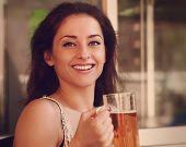 Happy Woman Drinking Beer In Pab. Closeup Vintage Portrait