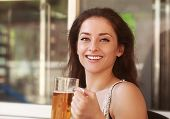 Laughing Woman Drinking Lager Beer In Bar