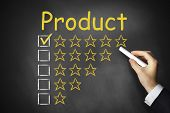 Hand Writing Product Golden Rating Stars On Chalkboard