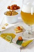 Unfiltered Beer And Spicy Crackers
