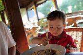 Child Eating Noodles