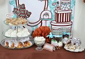 image of fancy cakes  - Homemade fancy set table with sweets candies cake marshmallows zephyr nuts almonds truffle as a present for birthday party - JPG