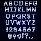 Vector bold chrome and blue neon alphabet letters  on dark background