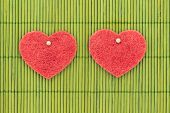 Symbols Of Hearts And Love Against Bamboo Sticks
